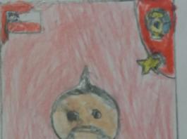 Niño dibuja cromos